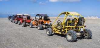 Beach buggies on tour on an excursion on the Canary Island Fuerteventura.
