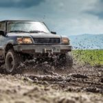 Off road vehicle splashed mud